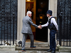 © Licensed to London News Pictures. 19/10/2017. London, UK. Former president of the United States of America, BILL CLINTON shakes the hand of a police officer as he arrives at 10 Downing Street in London for a meeting with British prime minister THERESA MAY. The pair are due to discuss the current political deadlock in Northern Ireland in an attempt to restore the power-sharing executive. Photo credit: Ben Cawthra/LNP