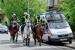 Mounted Police prepare to form a cordon as anti-fascists gather to protest against a march held by the English Defence League. May 2015 Walthamstow London