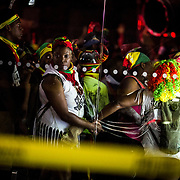 September 5, 2016. Parade attendees watch as crime scene detectives investigate the scene of a shooting that took place at the parking lot of a Wendy's on Empire Blvd during J'ouvert in Brooklyn, New York. John Taggart for The New York Times.