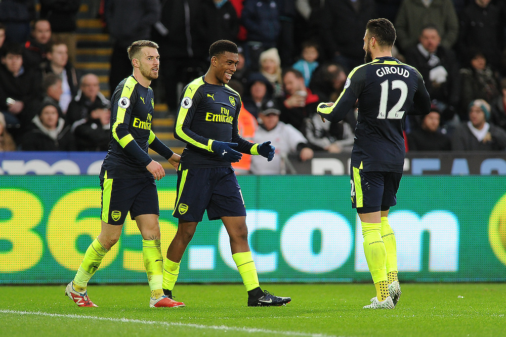 CELE - Arsenal's Alex Iwobi celebrates scoring his sides second goal <br /> <br /> Photographer /Ashley Crowden CameraSport<br /> <br /> The Premier League - Swansea City v Arsenal  - Saturday 14th January 2017 - Liberty Stadium - Swansea <br /> <br /> World Copyright © 2017 CameraSport. All rights reserved. 43 Linden Ave. Countesthorpe. Leicester. England. LE8 5PG - Tel: +44 (0) 116 277 4147 - admin@camerasport.com - www.camerasport.com