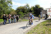 France, April 13th 2014: Riders chasing the lead group pass through Pont Gibus, Wallers, during the 2014 Paris Roubaix cycle race.