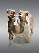 Bronze Age Anatolian terra cotta vtwo headed bull shaped ritual vessel - 19th to 17th century BC - Kültepe Kanesh - Museum of Anatolian Civilisations, Ankara, Turkey. Against a grey background. .<br /> <br /> If you prefer to buy from our ALAMY PHOTO LIBRARY  Collection visit : https://www.alamy.com/portfolio/paul-williams-funkystock/kultepe-kanesh-pottery.html<br /> <br /> Visit our ANCIENT WORLD PHOTO COLLECTIONS for more photos to download or buy as wall art prints https://funkystock.photoshelter.com/gallery-collection/Ancient-World-Art-Antiquities-Historic-Sites-Pictures-Images-of/C00006u26yqSkDOM