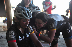 ROBERTSON, SOUTH AFRICA - MARCH 20: Anna Garcia and Sandra Coronilla from LIV Trail Squad are comforted by team mates at the finish of stage two's 110km from Robertson on March 20, 2018 in Cape Town, South Africa. Mountain bikers from across South Africa and internationally gather to compete in the 2018 ABSA Cape Epic, racing 8 days and 658km across the Western Cape with an accumulated 13 530m of climbing ascent, often referred to as the 'untamed race' the Cape Epic is said to be the toughest mountain bike event in the world. (Photo by Dino Lloyd)
