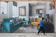 A Londoner walks past a marketing billboard for The Levers - a new apartment development on the Walworth Road at Elephant And castle, on 4th September 2018, in Southwark, London, England. The Levers (A Peabody development) will be a complex of 1,2,and 3 bed flats close to Elephant & Castle and Elephant Park - both undergoing major redevelopment.