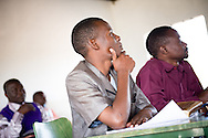 Pastoral students listen to the Rev. Dr. Lawrence R. Rast, Jr., president of Concordia Theological Seminary in Fort Wayne, Ind., as he teaches class at the Evangelical Lutheran Church in Tanzania – South-East of Lake Victoria Diocese (ELCT-SELVD) Bishop Emmanuel Makala Training Center on Friday, March 13, 2015, in Shinyanga, Tanzania. LCMS Communications/Erik M. Lunsford