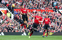 Manchester United's Alexis Sanchez (left) heads the ball towards the goal before being ruled offside during the Premier League match at Old Trafford, Manchester.