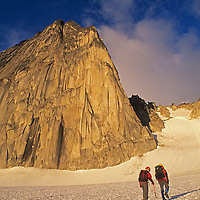 Mountaineers cross the Crescent Glacier below Snowpatch Spire in Bugaboo Provincial Park, British Columbia, Canada.