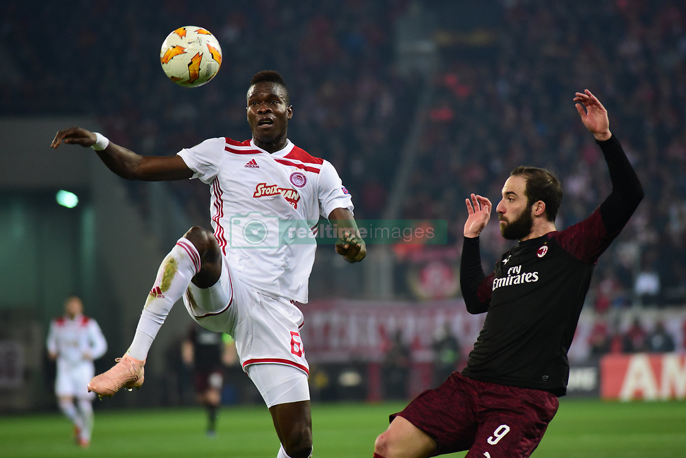 December 13, 2018 - Piraeus, Attiki, Greece - Pape Abou Cisse (no 66) of Olympiacos and Gonzalo Higuain (no 9) of Milan, vies for the ball. (Credit Image: © Dimitrios Karvountzis/Pacific Press via ZUMA Wire)