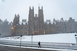 Edinburgh, Scotland, UK. 9 Feb 2021. Big freeze continues in the UK with Storm Darcy bringing several inches of snow to Edinburgh overnight. Pic; Blizzard on The Mound with New College to rear. Iain Masterton/Alamy Live news
