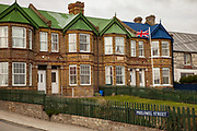 Union Jack flag and brick homes. Stanley, capital of Falkland Islands.