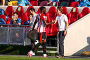 Brentford forward Josh Dasilva (14) is substituted and is congratulated by Brentford Head Coach Thomas Frank during the EFL Sky Bet Championship match between Brentford and Huddersfield Town at Brentford Community Stadium, Brentford, England on 19 September 2020.
