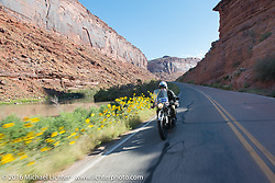 John Landstrom riding his 1928 BMW R62 on Utah Highway 128 north of Moab during stage 11 (289 miles) of the Motorcycle Cannonball Cross-Country Endurance Run, which on this day ran from Grand Junction, CO to Springville, UT., USA. Tuesday, September 16, 2014.  Photography ©2014 Michael Lichter.