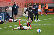 Cheltenham Town forward Andy Williams (14) is fouled by Archie Davies (15) of Crawley Town during the EFL Sky Bet League 2 match between Cheltenham Town and Crawley Town at Jonny Rocks Stadium, Cheltenham, England on 10 October 2020.