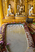 07 JUNE 2014 - YANGON, YANGON REGION, MYANMAR: A footprint of the Buddha at Shwedagon Pagoda in Yangon. Shwedagon Pagoda is officially called Shwedagon Zedi Daw and is also known as the Great Dagon Pagoda and the Golden Pagoda. It's a 99 metres (325 ft) gilded pagoda and stupa located in Yangon. It is the most sacred Buddhist pagoda in Myanmar with relics of the past four Buddhas enshrined within: the staff of Kakusandha, the water filter of Koṇāgamana, a piece of the robe of Kassapa and eight strands of hair from Gautama, the historical Buddha.   PHOTO BY JACK KURTZ