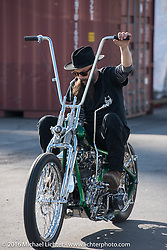 Ryan Grossman of Vintage Dreams on his rigid frame high bar Harley-Davidson Knucklehead at the Yokohama docks where the invited custom builder's bikes from the USA were unloaded prior to the Mooneyes Yokohama Hot Rod & Custom Show. Yokohama, Japan. December 3, 2016.  Photography ©2016 Michael Lichter.
