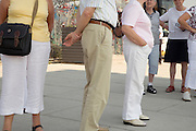 elderly tourists at an old section of the Berlin Wall East Gallery
