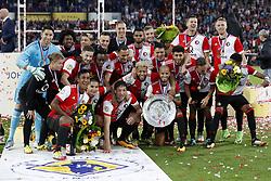 (L-R) keeper Brad Jones of Feyenoord, Miguel Nelom of Feyenoord, Jan-Arie van der Heijden of Feyenoord, Renato Tapia of Feyenoord, Kevin Diks of Feyenoord, Ridgeciano Haps of Feyenoord, Eric Botteghin of Feyenoord, Sofyan Amrabat of Feyenoord, Tonny Vilhena of Feyenoord, Jeremiah St. Juste of Feyenoord, Steven Berghuis of Feyenoord, Karim El Ahmadi of Feyenoord, Bilal Basacikoglu of Feyenoord, Michiel Kramer of Feyenoord, Jens Toornstra of Feyenoord, Nicolai Jorgensen of Feyenoord, Jean-Paul Boetius of Feyenoord (L-R) Jens Toornstra of Feyenoord, Kevin Diks of Feyenoord, Eric Botteghin of Feyenoord, Tonny Vilhena of Feyenoord, Jeremiah St. Juste of Feyenoord,  Susila Cruijff, keeper Brad Jones of Feyenoord,  Karim El Ahmadi of Feyenoord, Jean-Paul Boetius of Feyenoord with the Johan Cruijff shield during the Johan Cruijff Shield match between between Feyenoord Rotterdam and Vitesse Arnhem at the Kuip on August 05, 2017 in Rotterdam, The Netherlands