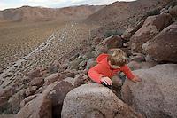 5 year old boy climbing a ridge in the Anza-Borrego Desert
