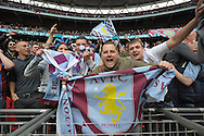 Aston Villa fans celebrate after the final whistle as they book their place in the FA Cup Final.The FA Cup, semi final match, Aston Villa v Liverpool at Wembley Stadium in London on Sunday 19th April 2015.<br /> pic by John Patrick Fletcher, Andrew Orchard sports photography.
