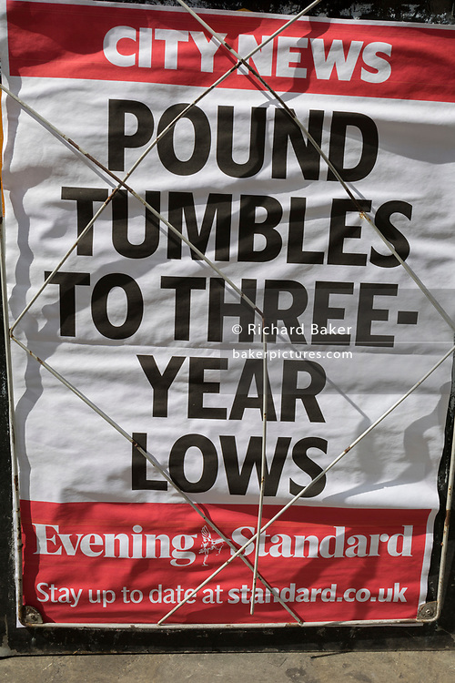 A detail of the London Evening Standard vendor with a headline dated 3rd September about a falling Pound rate, the consequences of a possible No-deal Brexit, in the City of London, (aka The Square Mile) the capital's financial district, on 3rd September 2019, in London, England.