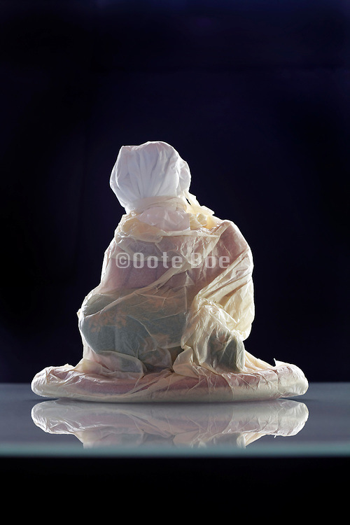 Japanese geisha doll wrapped up in protective paper