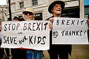 On 2nd anniversary of Brexit , June 23rd 2018, around 100,000 people marched in Central London demanding a People's Vote on the final Brexit deal. An older woman from Cheam holds a poster saying Stop Brexit and save our kids whilst her husband holds one saying Brexit, No thanks.