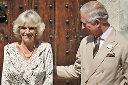 File photo dated 17/07/13 of the Duchess of Cornwall with the Prince of Wales as crowds applaud her birthday outside the Duchy Palace in Lostwithiel. Charles and Camilla are celebrating their 15th wedding anniversary on Friday, after they were reunited on Monday when the 72-year-old duchess came out of a 14-day self-isolation on the Balmoral estate in Aberdeenshire.