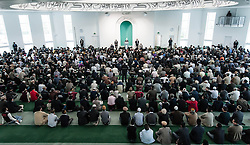 © Licensed to London News Pictures. 21/09/2012. London,UK.  Local muslims listen to His Holiness Hadhrat Mirza Masrror Ahmad give a sermon at the Baitul Futuh Mosque in Morden, London, in the wake of  protests across the Islamic world against the film 'Innocence of Muslims'.  His Holiness Hadhrat Mirza Masrror Ahmad is the Khalifa and worldwide muslim leader for Islam.   The Baitul Futuh Mosque is the largest mosque in Europe.  Photo credit : Richard Isaac/LNP
