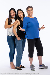 Sisters Alma Chavez (L) with her sister Yoli and Vicki Kinzie (R) at the Intercambio portrait Shoot. Longmont, CO, USA. June 5, 2021. Photography ©2021 Michael Lichter. Usage rights granted to Intercambio Uniting Communities and its assigns.