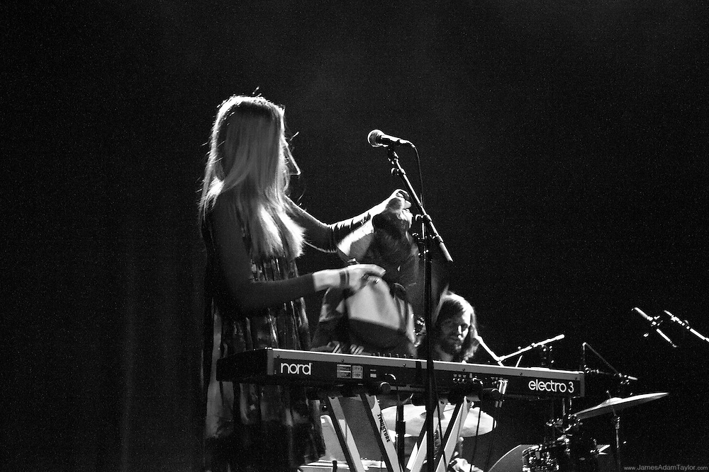 Klara Söderberg opening a gift form a fan durring the First Aid Kit live performance at Union Transfer in Philadelphia.