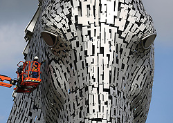 Embargoed to 0001 Monday May 29 Mick Clare carries out the first health check on the Kelpies in Falkirk, as they approach their third birthday.