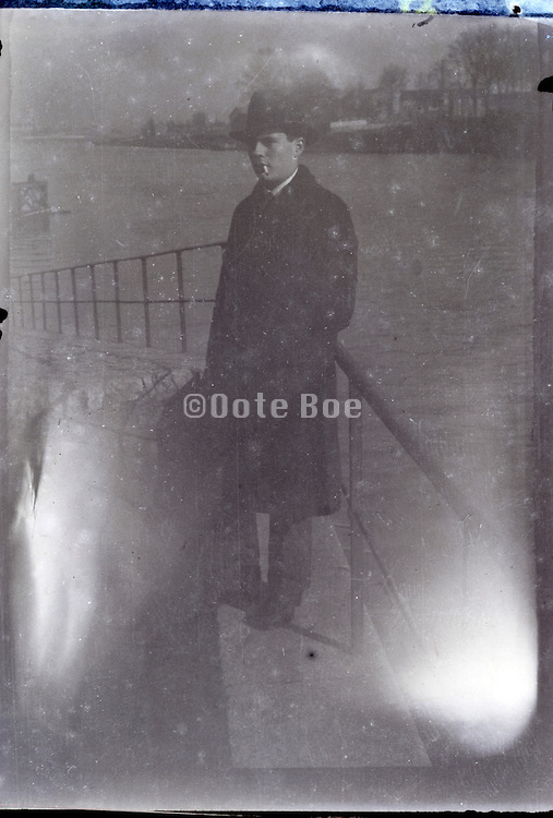 fading image of man by railing 1930s