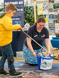Dynamic Earth, Edinburgh, Scotland, United Kingdom, 9 April 2019. Edinburgh Science Festival:  Jamie Carter, age 8 years, has fun learning about plastic pollution in the sea at Scrapbook: Fight Ocean Plastics from the Skies with Catherine Gemmell from Marine Conservation Society at Dynamic Earth at the Edinburgh Science Festival. <br /> <br /> Sally Anderson | EdinburghElitemedia.co.uk