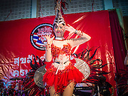 27 JULY 2013 - BANGKOK, THAILAND:  Thai women in Las Vegas style outfits provide entertainment for Thai Red Shirts at a birthday for Thaksin Shinawatra. The Red Shirts celebrated former Prime Minister Thaksin Shinawatra's 64th birthday with a party at Phibun Prachasan School in Bangkok. They had a Buddhist Merit Making Ceremony, dinner, cake and entertainment. Most of the Red Shirt political elite traveled to Hong Kong for a party with Thaksin. Thaksin, the former Prime Minister, was deposed by a coup in 2006 and subsequently convicted of corruption related crimes. He went into exile rather than go to jail but remains very popular in rural parts of Thailand. His sister, Yingluck Shinawatra is the current Prime Minister and was elected based on her brother's recommendation.    PHOTO BY JACK KURTZ