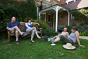 Volunteers on working retreat rest mid-morning at the Rivendell Buddhist Retreat Centre, East Sussex, England.