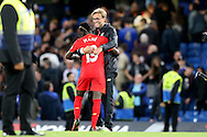 Jurgen Klopp, the Liverpool manager hugs Sadio Mane of Liverpool after the final whistle. Premier league match, Chelsea v Liverpool at Stamford Bridge in London on Friday 16th September 2016.<br /> pic by John Patrick Fletcher, Andrew Orchard sports photography.
