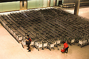 Airline passengers collect trolleys in the baggage reclaim hall in the arrivals of Heathrow Airport's Terminal 5.