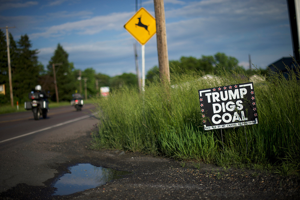 """MARION HEIGHTS, PA - June 6, 2016.   A sign stating """"Trump Digs Coal"""" is displayed roadside in Mario Heights, PA on June 6, 2016.  Republican Presidential hopeful Donald J. Trump aspires to put the rust belt into play."""