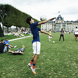 "PARIS, FRANCE. AUGUST 23, 2011. The French homeless team at the Homeless World Cup, during training on the Champs de Mars with the ""Artillerie"" in the background. Photo: Antoine Doyen"