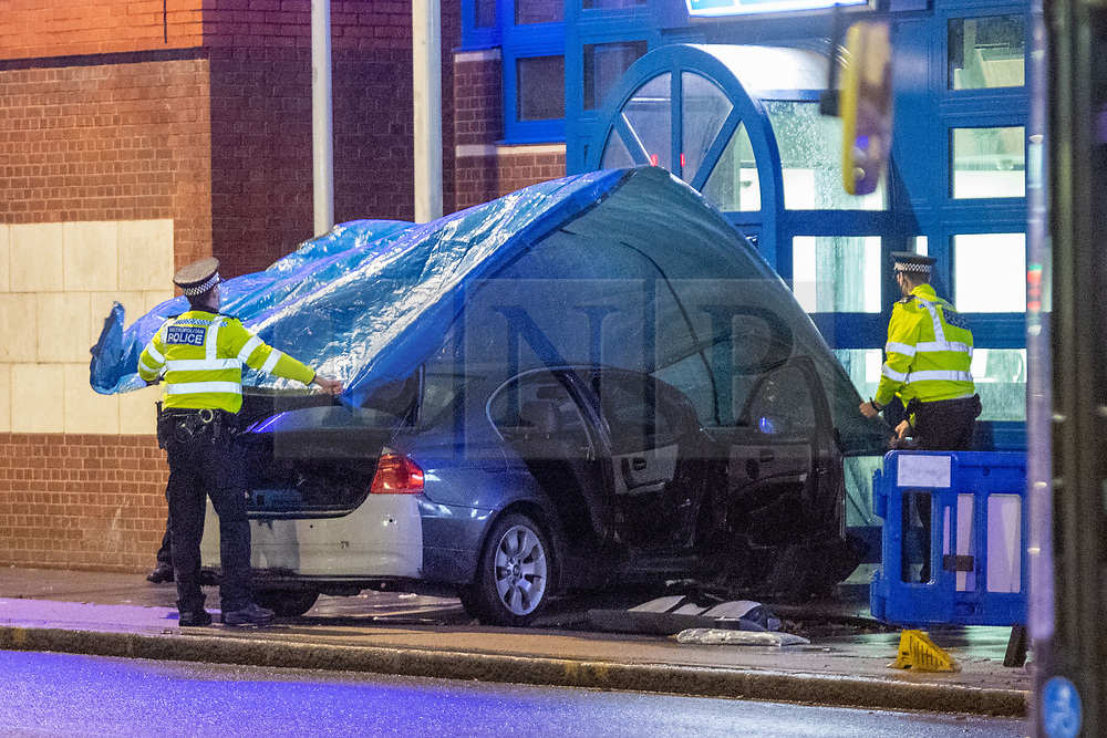 © Licensed to London News Pictures. 11/11/2020. London, UK. Police officers cover a vehicle at the entrance of Edmonton Police station. A vehicle has crashed into Edmonton police station, the incident occurred at approximately 18:58GMT. Photo credit: Peter Manning/LNP