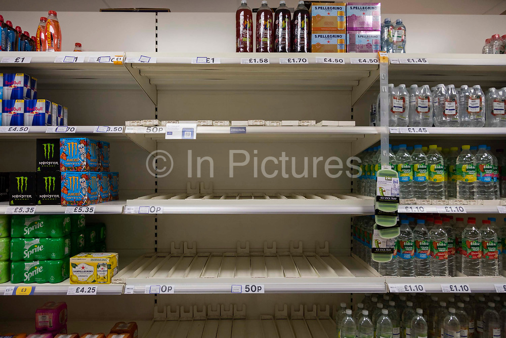 Rows of empty shelves in British supermarket chain Tesco amidst nationwide labour shortages on 4th September, 2021 in Leeds, United Kingdom. A combination of Brexit and Covid-19 is reportedly exacerbating an already severe staff shortage in the British workforce, with a lack of HGV drivers leading to empty shelves in supermarkets up and down the country.