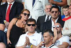 Coleen Rooney points to the pitch  - Mandatory byline: Joe Meredith/JMP - 07966386802 - 05/09/2015 - FOOTBALL- INTERNATIONAL - San Marino Stadium - Serravalle - San Marino v England - UEFA EURO Qualifers Group Stage