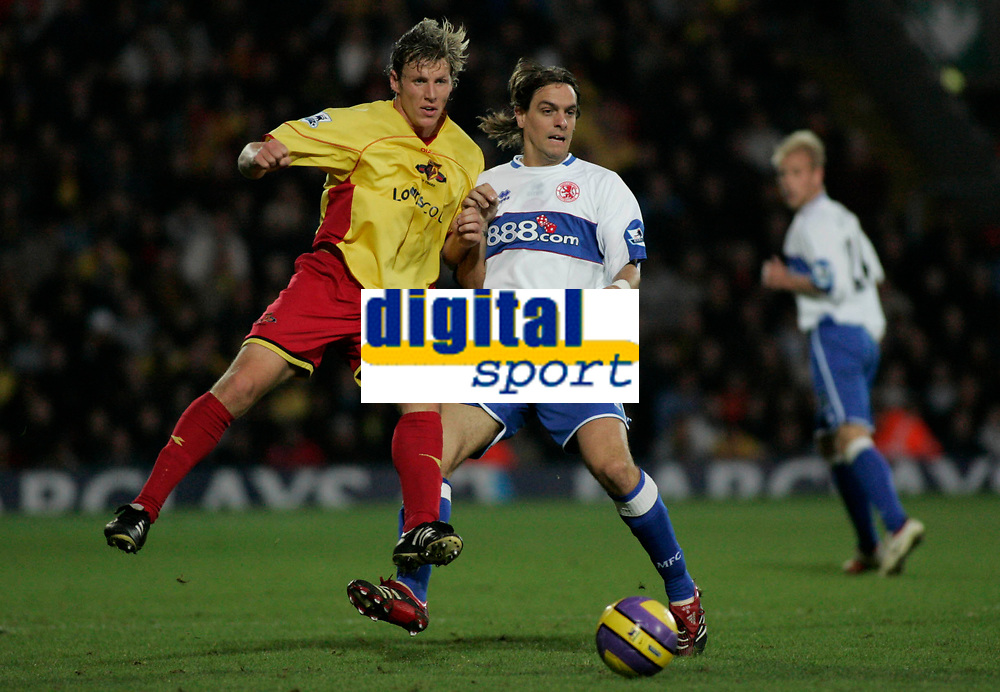 Photo: Marc Atkins.<br />Watford v Middlesbrough. The Barclays Premiership. 04/11/2006. Darius Henderson (L) of Watford in action with Jonathan Woodgate (R) of Boro.