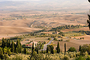 View from the walled town of Pienza, Italy. Revisit with the Pellegrini family, 2005, Pienza, Italy. The Pellegrinis were Italy's participants in Material World: A Global Family Portrait, 1994 (pages: 198-199), for which they took all of their possessions out of their house for a family-and-possessions-portrait. In 1996, UNESCO declared the town a World Heritage Site.