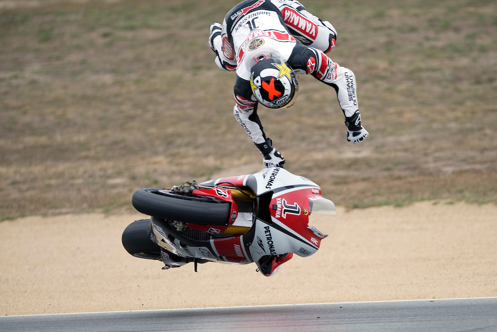 Yamaha's Jorge Lorenzo takes a high-side crash at turn 5 during Saturday morning practice at the 2011 Red Bull U.S. Moto Grand Prix at Mazda Raceway Laguna Seca. Lorenzo qualified in pole position that afternoon and finished the race in second the next day.