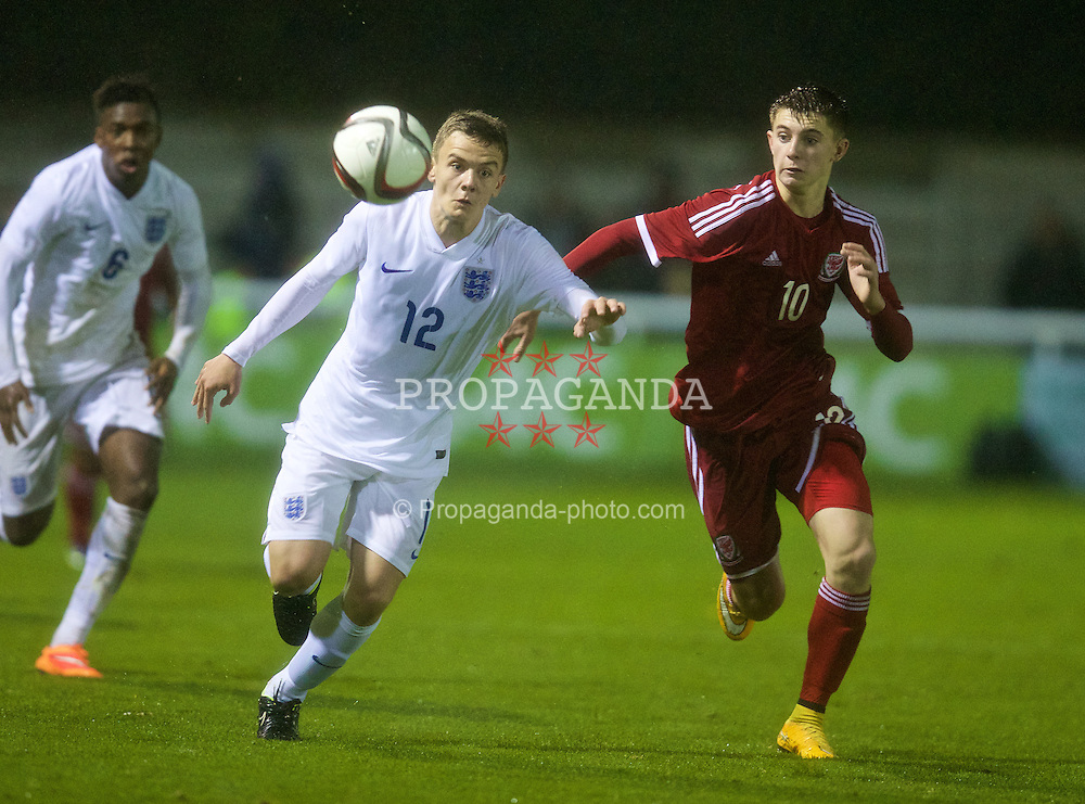 BANGOR, WALES - Friday, October 31, 2014: Wales' Ben Woodburn in action against England's Lewis Thompson during the Under-16's Victory Shield International match at the Nantporth Stadium. (Pic by David Rawcliffe/Propaganda)