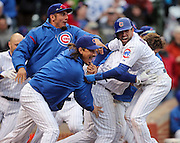 The Chicago Cubs mob David DeJesus (9) as he scores the game-winning run on Starlin Castro's hit to defeat the San Francisco Giants on Friday, April 12, 2013 at Wrigley Field. (Brian Cassella/Chicago Tribune)  B582829127Z.1 <br /> ....OUTSIDE TRIBUNE CO.- NO MAGS,  NO SALES, NO INTERNET, NO TV, CHICAGO OUT, NO DIGITAL MANIPULATION...