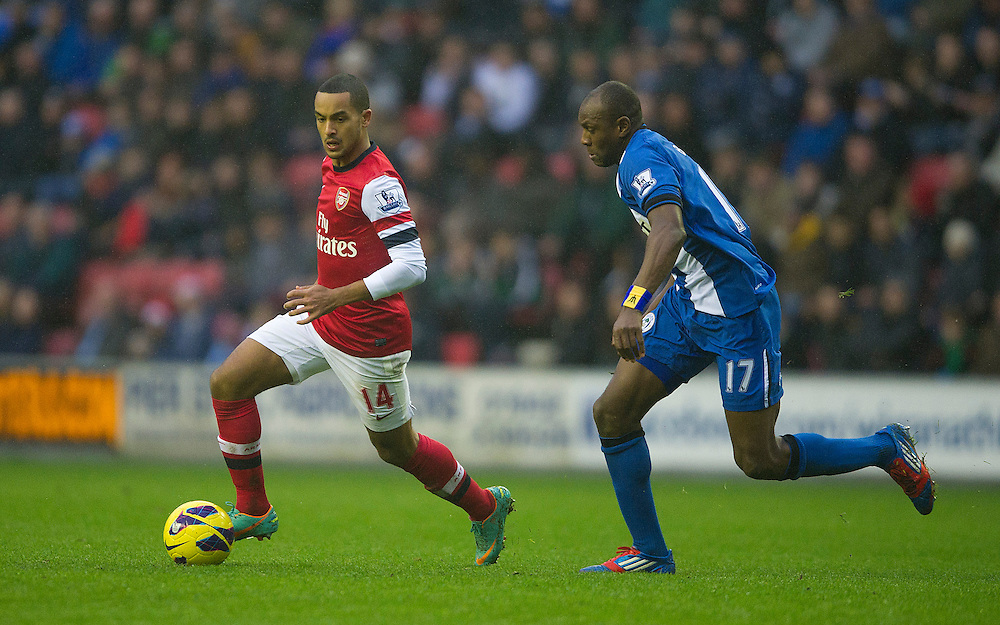 Arsenal's Theo Walcott is chased by Wigan Athletic's Emmerson Boyce ..Football - Barclays Premiership - Wigan Athletic v Arsenal - Saturday 22nd December 2012 - DW Stadium - Wigan..