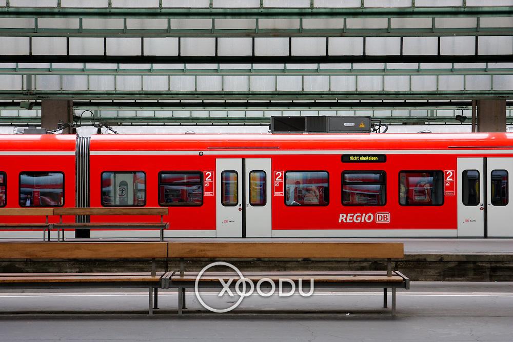 Red passenger train by platform in Stuttgart station (Stuttggart, Germany - Jun. 2008) (Image ID: 080614-1039441a)