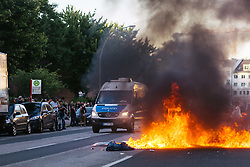 July 7, 2017 - Hamburg, Germany - Burning cars and barriers in Louise-Schroeder-Strasse. // Brennendes Auto und Barrikade in der Louise-Schroeder-Strasse.Credit: MilesMeyer/face to face (Credit Image: © face to face via ZUMA Press)